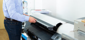Portrait of male worker at plotter